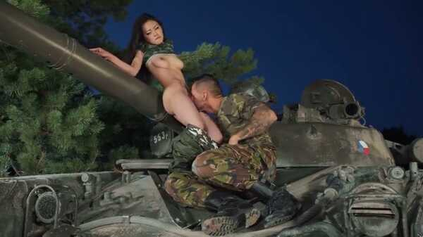 Asian woman has sex on a tank.
