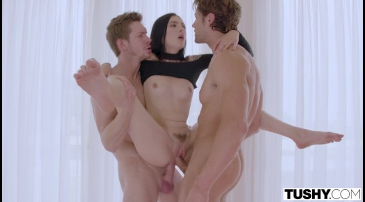 Brunette Marley Brinx takes in two dicks at once.