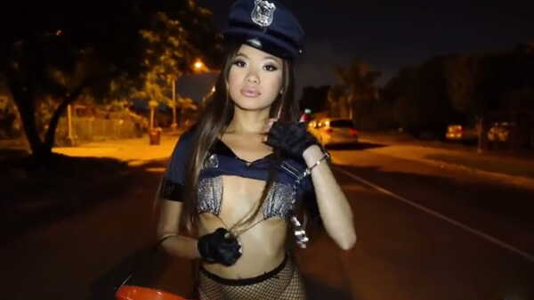 Sexy police girl handing out sweets.