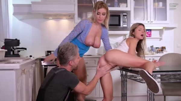 Porn video Two blondes fuck with a plumber in the kitchen.